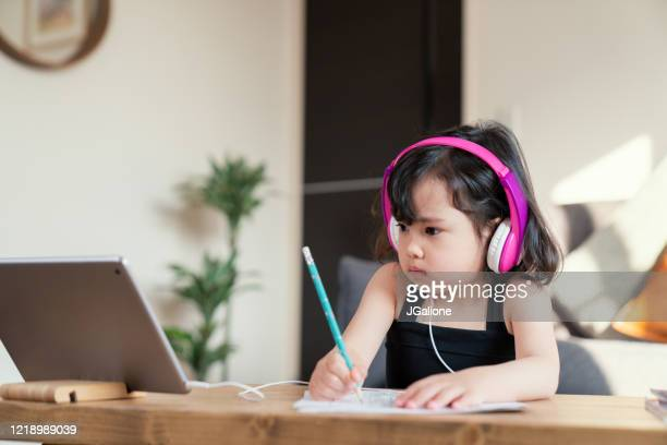 young girl studying at home alone - jgalione stock pictures, royalty-free photos & images