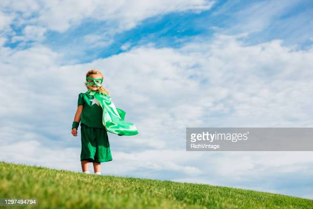young girl superhero - cape stock pictures, royalty-free photos & images