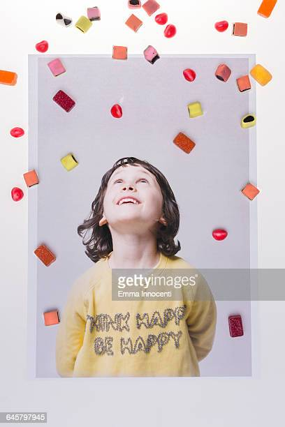 Young girl surrounded by sweets