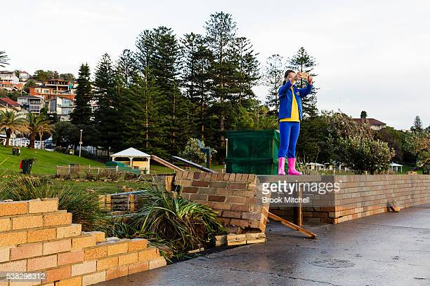 A young girl surveys the damage at Bronte beach on June 6 2016 in Sydney Australia Torrential rain over the weekend saw streets and homes flooded...