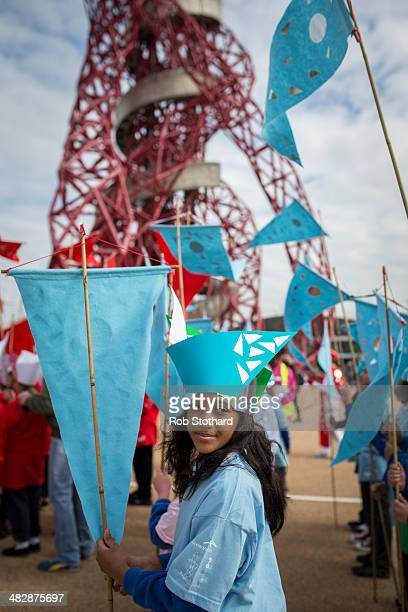 A young girl takes part in an opening parade at the Olympic Park on April 5 2014 in London England The Queen Elizabeth Olympic Park in east London...