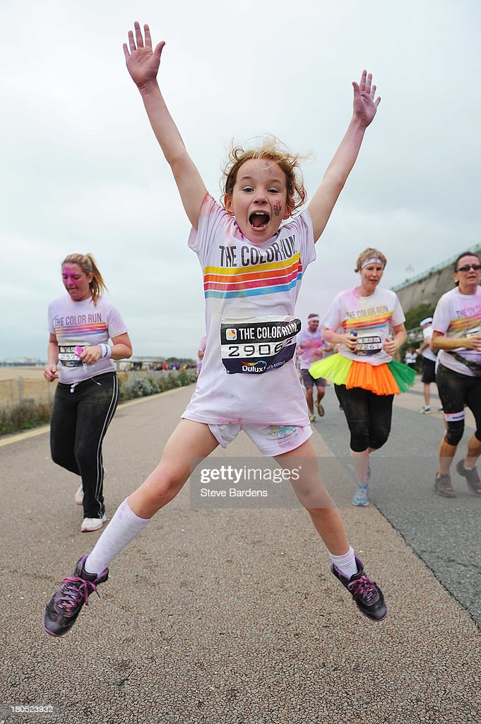 A young girl takes part in The Color Run presented by Dulux, known as the happiest 5km on the planet on September 14, 2013 in Brighton, England. Runners of all shapes, sizes and speeds start wearing white clothing that is a blank canvas for the kaleidoscope of colours they encounter around The Color Run course. At each kilometre a different colour of powder is thrown in the air with the runners becoming a constantly evolving artwork. At the end of the course runners are greeted by the Colour Festival where the air is filled with music and stunning coloured powder bursts creating a vibrant party atmosphere.