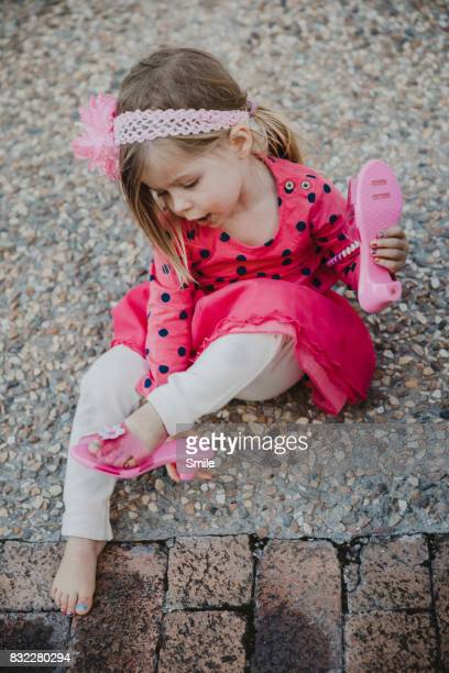 young girl taking off her shoes - girl strips stock pictures, royalty-free photos & images