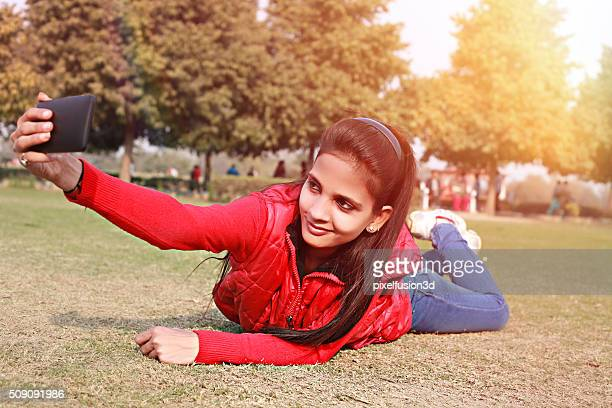 Young girl taking selfie in the park