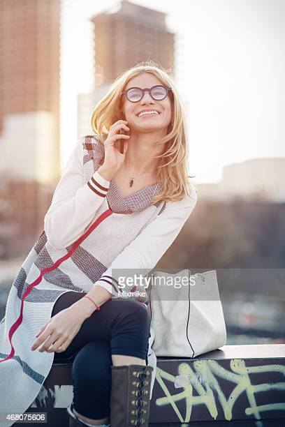 young girl talking on the phone in the city - tall blonde women stock photos and pictures