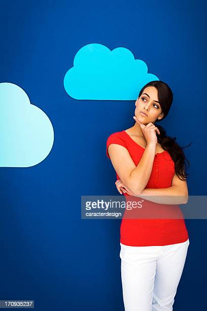 Young girl thinking among clouds