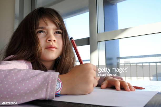 Young girl thinking inspiration