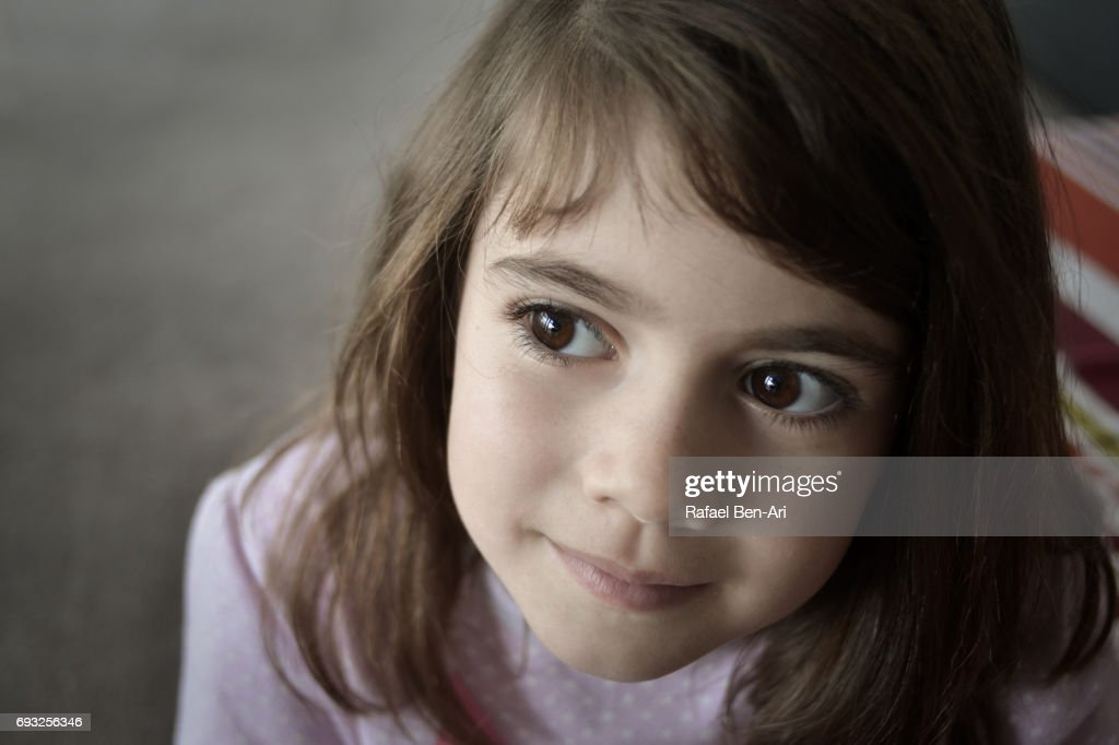 Young girl thinking : Stock Photo