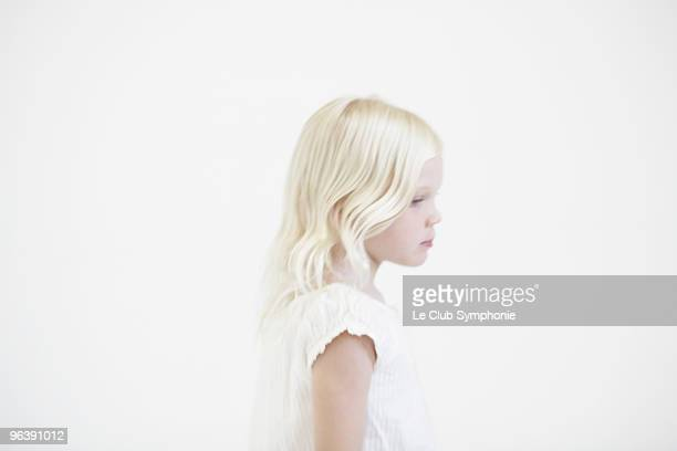 Young girl thinking, profile