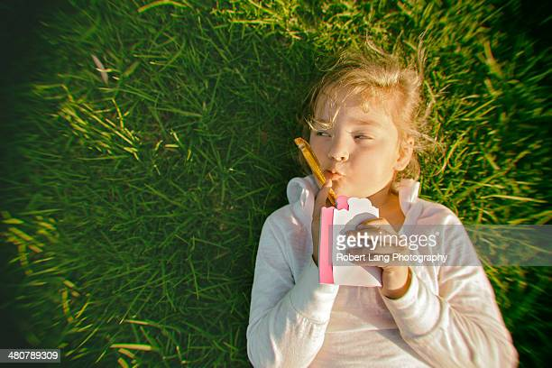 Young girl thinking to write in a love letter