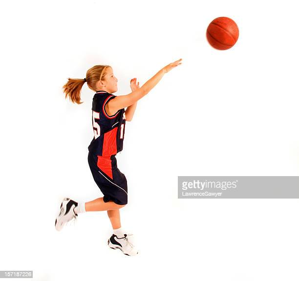 Young girl throwing basketball