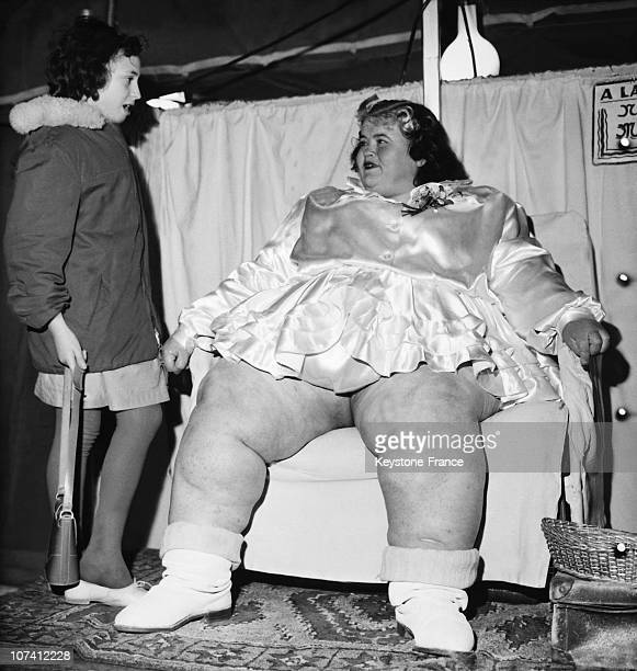 Young Girl Transfixed Before A Young Woman Weighting 207 Kilos At Foire Du Trone In Paris On March 1961