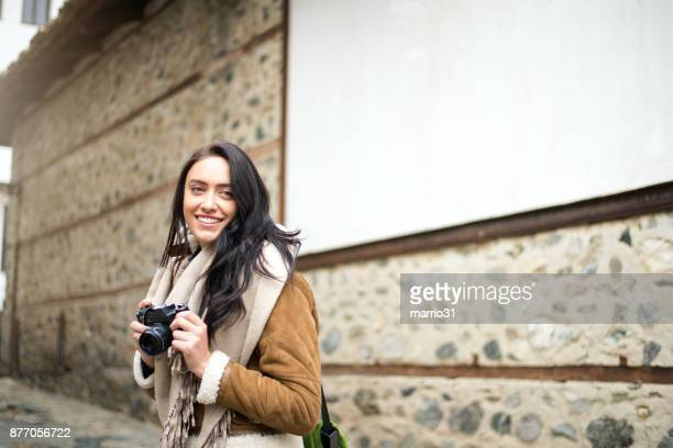 young girl traveler with camera - camera girls stock photos and pictures