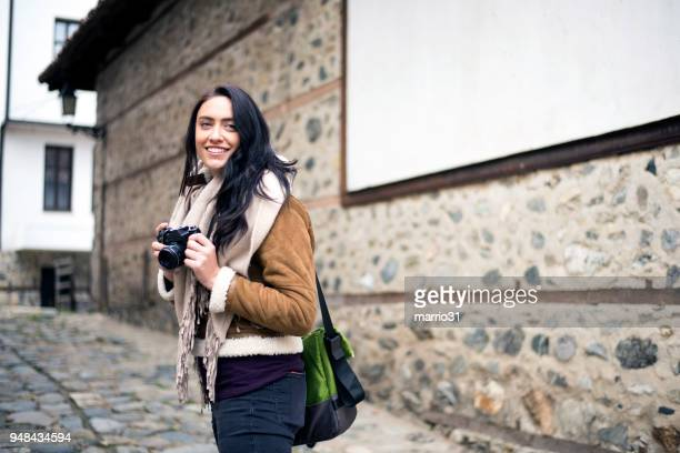 Young girl traveler with camera