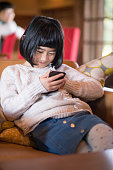 young girl typing message smart phone