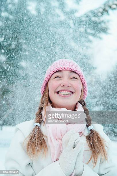 """young girl under falling snow. - """"martine doucet"""" or martinedoucet stock pictures, royalty-free photos & images"""