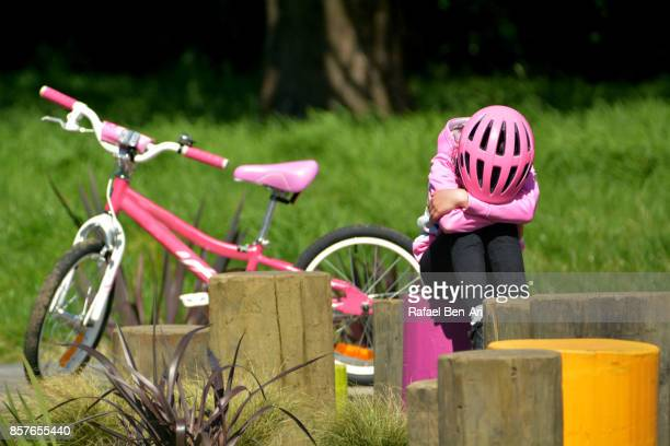 Young Girl Upset from Riding Bike