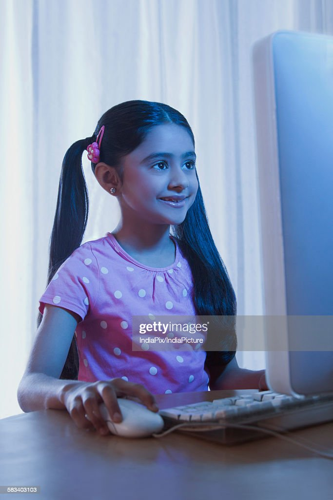 Young girl using a computer : Stock Photo