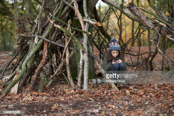 Young girl using a smartphone in the woods