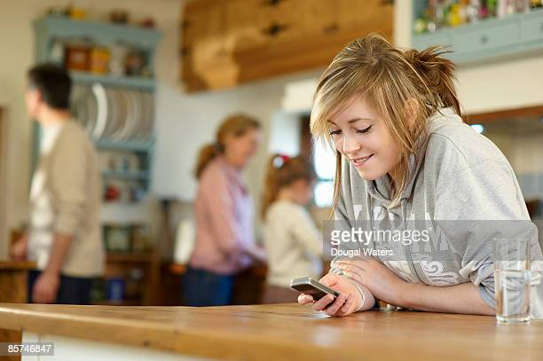 young girl using mobile phone. - incidental people stock pictures, royalty-free photos & images