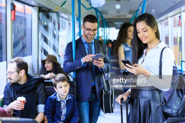 Young girl using smart phone in bus