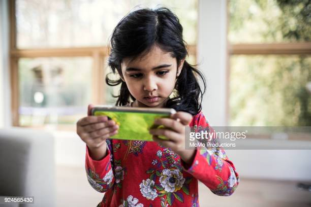 Young girl using smartphone at home