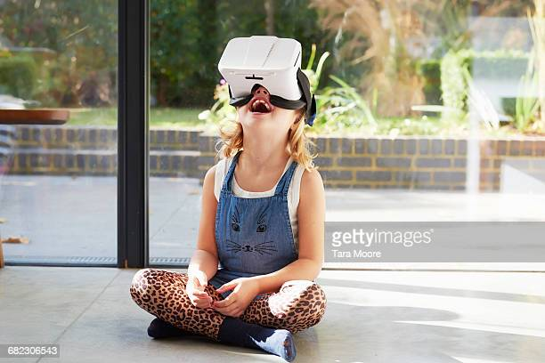 young girl using virtual reality headset - virtual reality simulator stock photos and pictures