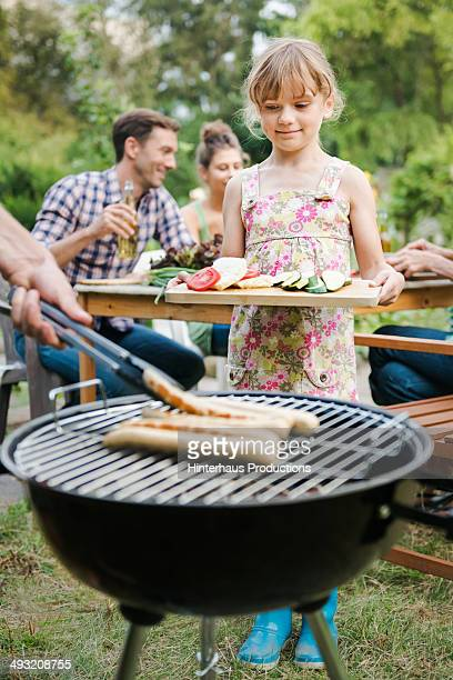 Young Girl Waiting At BBQ Grill
