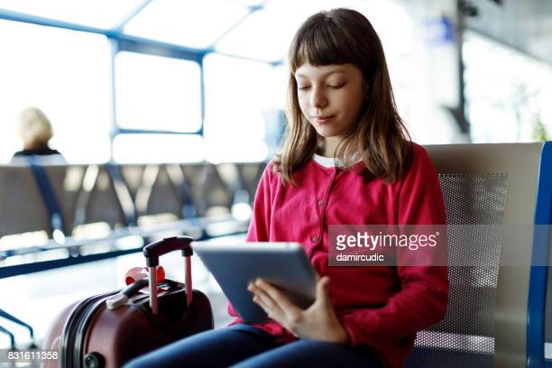 Young girl waiting for her flight