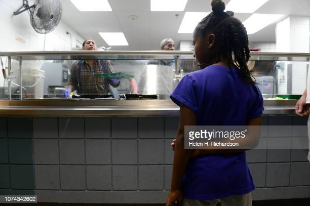A young girl waits in line for dinner at the Samaritan House on December 17 2018 in Denver Colorado Through a series of medical problems losing jobs...