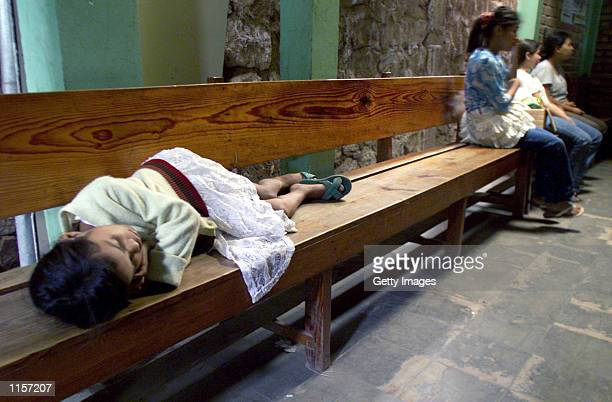 A young girl waits to be treated for Hemorrhagic Dengue at the Las Cruzes Medical Center July 23 2002 in Tegucigalpa Honduras An outbreak of...