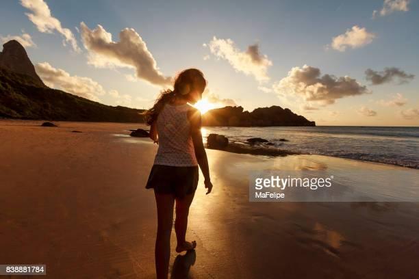 Young girl walking at the beach in Fernando de Noronha