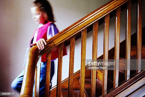 Young Girl Walking Down Stairs