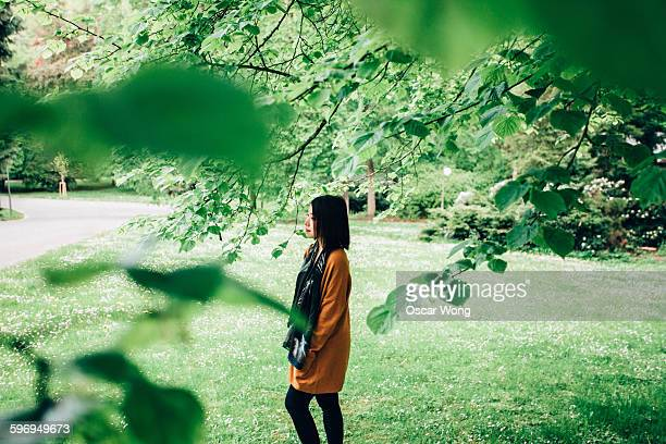 young girl walking in park over weekend - hyde park london stock photos and pictures