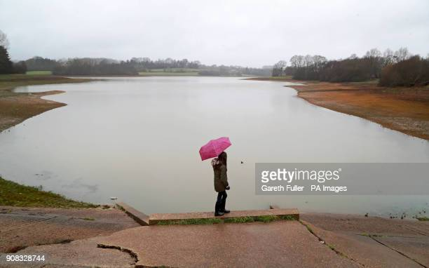 A young girl walks along the edge of Bewl Water reservoir during heavy rain near Lamberhurst Kent after Southern Water was granted a drought permit...