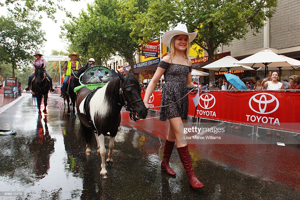 A young girl walks her horse along Peel Street during the Tamworth Country Music Festival Calvacade takes place along Peel Street on January 23, 2016 in Tamworth, Australia. The Tamworth Country Music Festival is a 10 day event showcasing over 700 artists and draws large crowds enjoying the annual Australia Day weekend, culminating in the Golden Guitar Awards which celebrates the best of Australian country music.