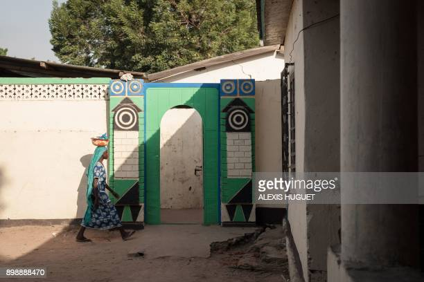 A young girl walks in the courtyard of the house of Oumar Garba the main notable and merchant of the city of Birao northern Central African Republic...