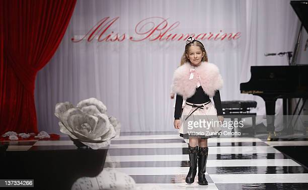 A young girl walks the runway of the Miss Blumarine fashion show as part of Pitti Immagine Bimbo 74 on January 19 2012 in Florence Italy