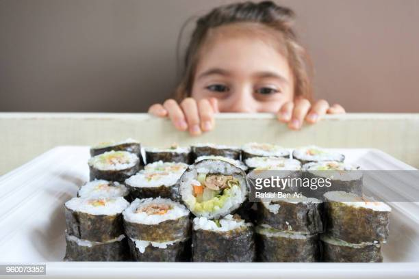 Young girl wants to eat Sushi