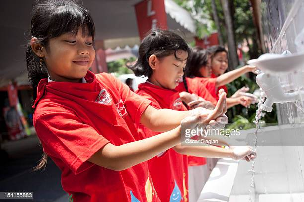 A young girl washes her hands with soap as part of Global Handwashing Day on October 15 2012 in Jakarta Indonesia Celebrated in over 100 countries...