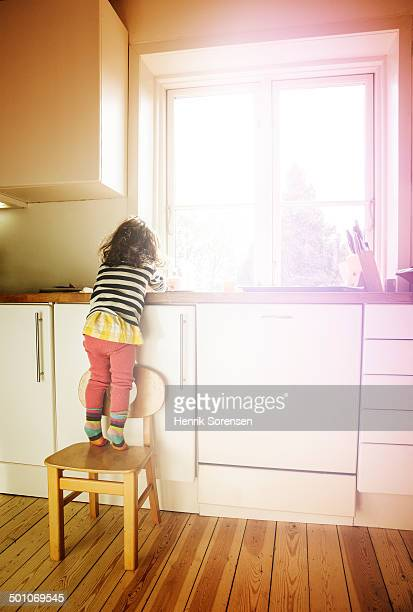 young girl washing hand in kitchen