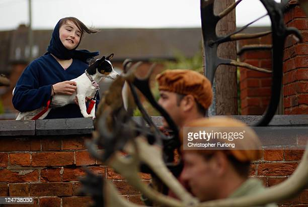 A young girl watches dancers perform the Abbots Bromley Horn Dance on September 12 2011 in Abbots Bromley United Kingdom The dance comprising of six...