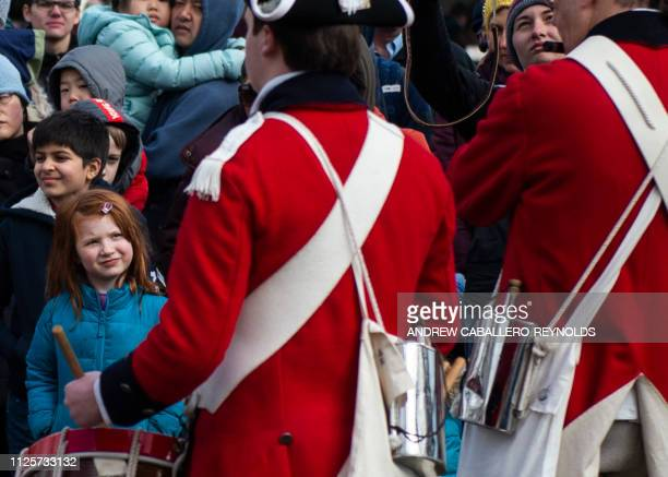 A young girl watches reenactors play drums as part of Presidents day events at George Washingtons' Mount Vernon estate in Mt Vernon Virginia on...