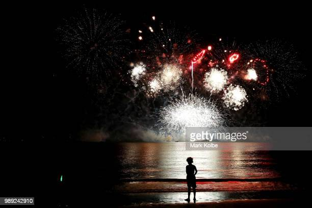 A young girl watches the fireworks display during Territory Day celebrations at Mindil Beach on July 1 2018 in Darwin Australia Every year on July 1...