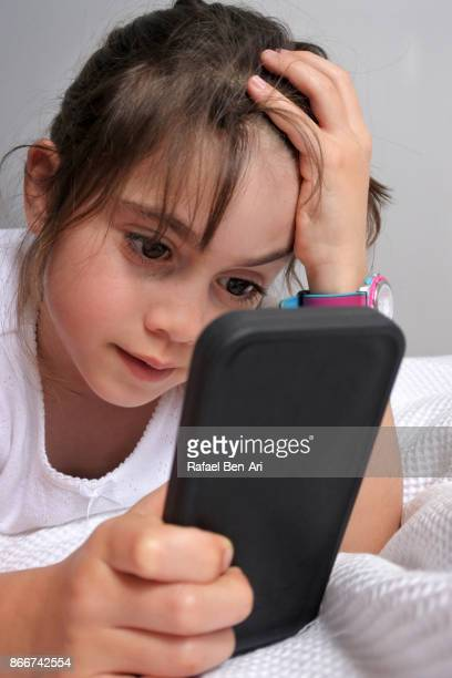 Young girl watching a video clip on a mobile phone