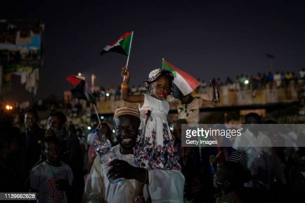 Young girl waves a flag as a big crowd gathers during evening protests against the military junta on April 27, 2019 in Khartoum, Sudan. After months...