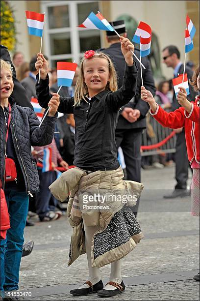 Young girl waves a flag on the street during the civil wedding ceremony of Prince Guillaume Of Luxembourg and Countess Stephanie de Lannoy at the...