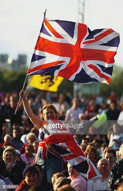 A young girl waves a Union Jack at the annual free outdoor concert 'Proms In The Park' on final day of the 110th season of the BBC Proms 2004 in Hyde...