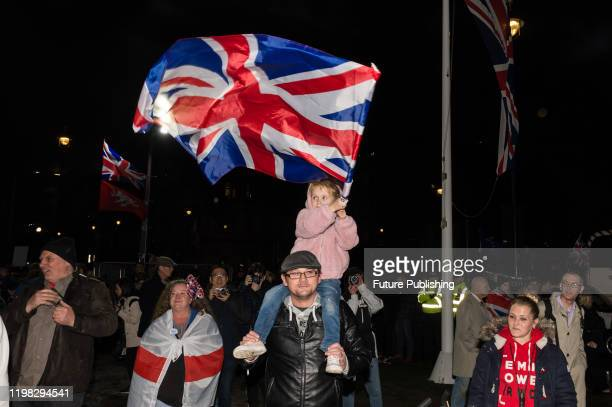 Young girl waves a Union Jack flag as thousands of pro-Brexit supporters take part in a rally celebrating Britain's departure from the EU in...