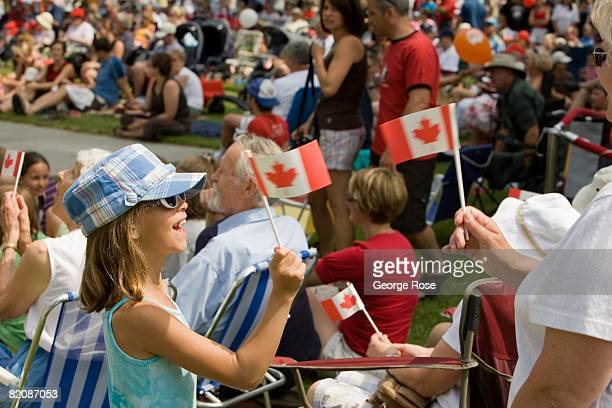 A young girl waves the Canadian maple leaf flag during Canada Day festivities in this 2008 Penticton British Columbia Canada summer photo Canada Day...